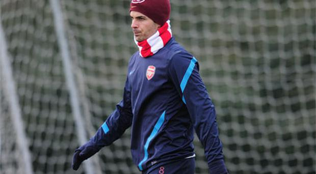 Mikel Arteta of Arsenal looks on during a training session at London Colney yesterday. Photo: Getty Images