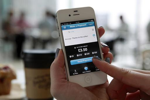 A smartphone with the Barclays Pingit App. Photo: PA