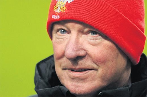 Alex Ferguson wears his lucky red Wales hat during Manchester United's training session in the Amsterdam Arena last night