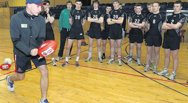 Tadhg Kennelly instructs the 15 young footballers who were invited to yesterday's AFL recruitment camp