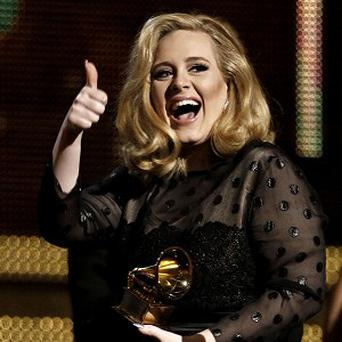 Adele says she's ready to write a 'happy' record