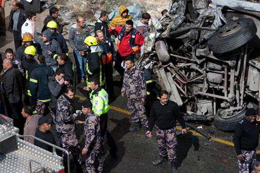 Israeli and Palestinian rescue workers and security personnel gather at the site of the crash. Photo: Getty Images