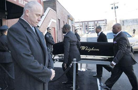 SOLEMN: A coffin holding the remains of singer Whitney Houston is carried into the New Hope Baptist Church before her funeral service yesterday