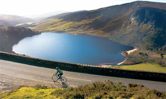 A club cyclist made the most of the fine spring sunshine yesterday at Luggala, overlooking Lough Tay near the Sally Gap, Co Wicklow