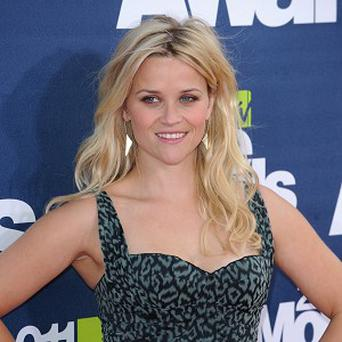 Reese Witherspoon learnt that men don't like flat shoes