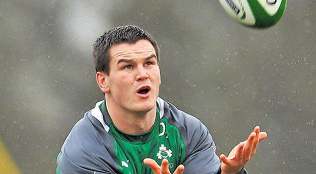 Jonathan Sexton, with his eyes on the ball at training in Maynooth yesterday, insists that both he and Ronan O'Gara have to 'accept' the decisions of Ireland coach Declan Kidney when it comes to the No 10 jersey