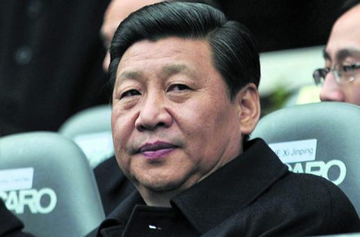 Chinese Vice President Xi Jinping watches a gaelic football match during a tour of Croke Park over the weekend
