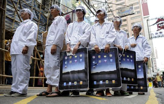 Participants dressed up to represent Foxconn workers take part in a protest against Taiwanese technology giant Foxconn in May 2011. Photo: Getty Images