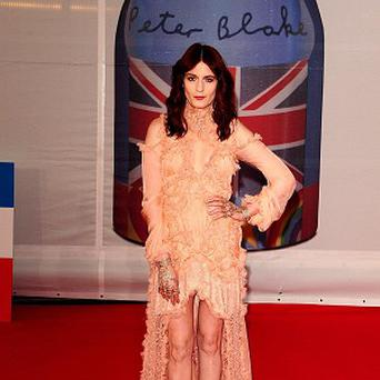 Florence Welch opted for a dramatic Alexander McQueen dress at the Brits