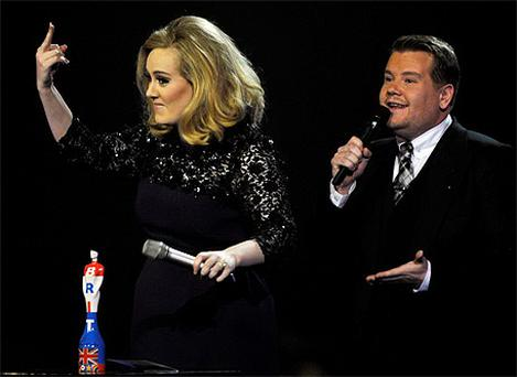 Adele gives the middle finger after her acceptance speech was cut short at the Brit Awards