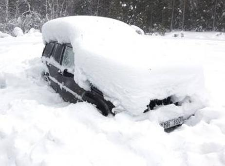 Peter Skyllberg's car was covered in snow 2ft deep before a group of snow mobilers discovered it. Photo: Getty Images