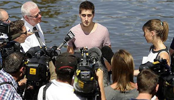Dave Brearley, 22, from Great Britain speaks to the media on the banks of the Yarra River in Melbourne, Australia