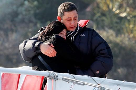 Susy Albertini, the mother of five-year-old victim Dayana Arlotti cries as a family member consoles her after visiting the site at Giglio island. Photo: Reuters