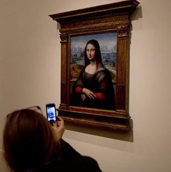 A woman takes a photo on a mobile phone of a Mona Lisa copy on display in Spain's Prado Museum in Madrid (AP)