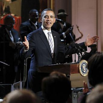 Barack Obama welcomes guests during a White House event saluting blues music (AP Photo/Pablo Martinez Monsivais)