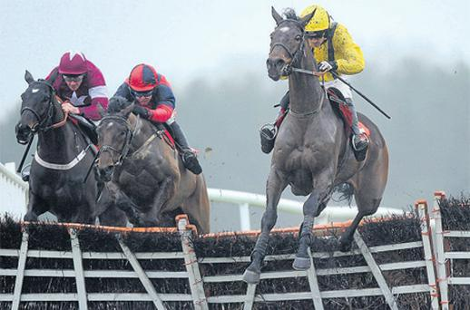Cousin Vinny, with Ruby Walsh up (right), jumps the last on the way to winning at Punchestown