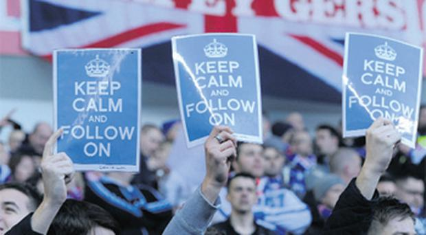 Rangers' fans display messages before their Scottish Premier League soccer match against Kilmarnock in Glasgow, Scotland, last Saturday. The club went into administration earlier last week following an unpaid tax bill to Britain's tax authorities