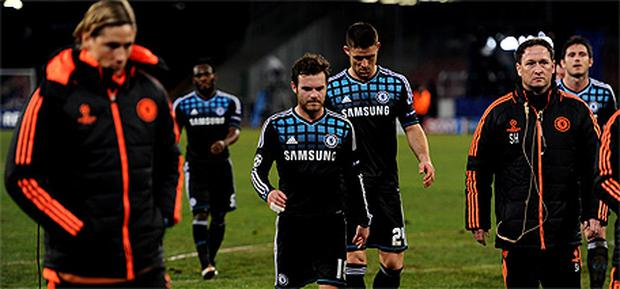 Chelsea players trudge off the pitch after their 3 - 1 humbling away to Napoli