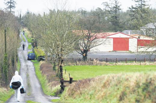 Gardai at the furniture premises in Kilmoyle, Co Longford, where the shooting incident took place yesterday