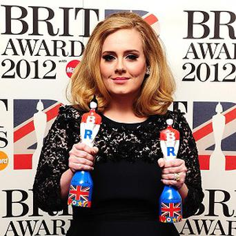 Adele with her two awards in the press room at the 2012 Brit Awards at The O2 Arena