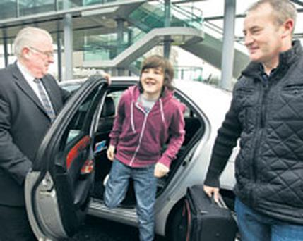 Oscar nominee Scott Graham and his dad Paul arriving at Dublin Airport yesterday.