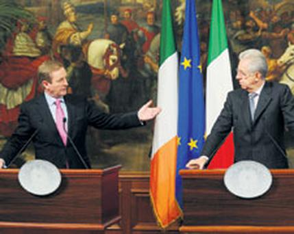 Taoiseach Enda Kenny meets with long-time acquaintance Italian Prime Minister Mario Monti at the Palazzo Chigi in Rome yesterday. Photo: NICK CORNISH