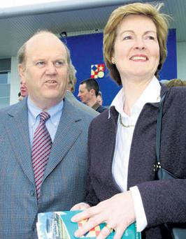 Michael Noonan and his wife Florence, pictured in his Limerick constituency in 2002