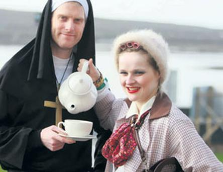 Robert Morgan, son of the late 'Father Ted' actor Dermot, having a cup of tea with Geraldine Hobbs (Mrs Doyle) at Ted Fest on Inis Mor yesterday