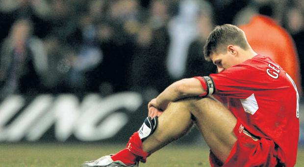 Liverpool's Gerrard bows his head as he sits on the pitch after losing the 2005 Carling Cup final to Chelsea, 3-2 in extra time.