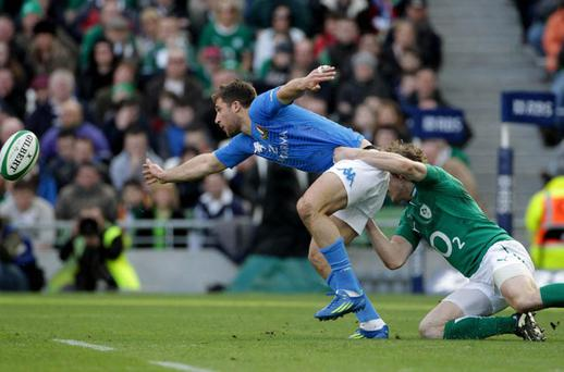 Ireland's Andrew Trimble tackles Italy's Tommaso Benvenuti during the RBS 6 Nations match at the Aviva Stadium, Dublin