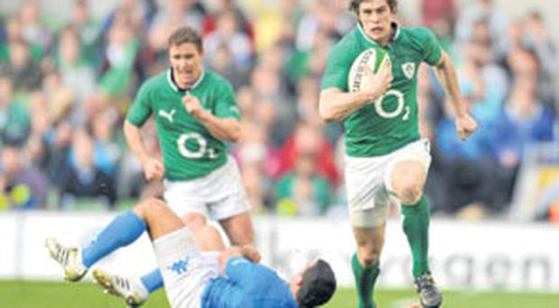 Andrew Trimble breaks away in the final moments to score Ireland's fifth and final try during yesterday's win over Italy at the Aviva Stadium. Photo: David Maher