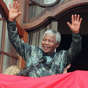 Nelson Mandela became South Africa's first black president in 1994 after spending 27 years in prison for his fight against racist apartheid rule