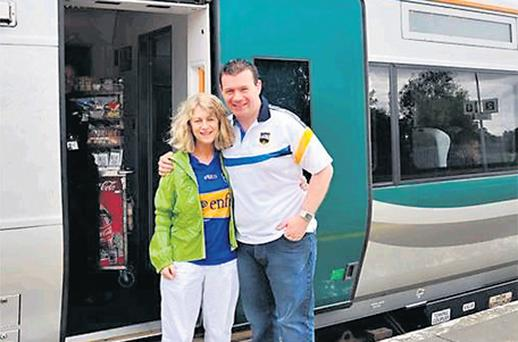 Transport Minister Alan Kelly boards the special train with Virginia O'Dowd, chair of the Nenagh Rail Partnership, before last September's All-Ireland hurling final