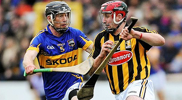 Eoin Larkin, Kilkenny, in action with Shane Maher, Tipperary. Photo: Sportsfile