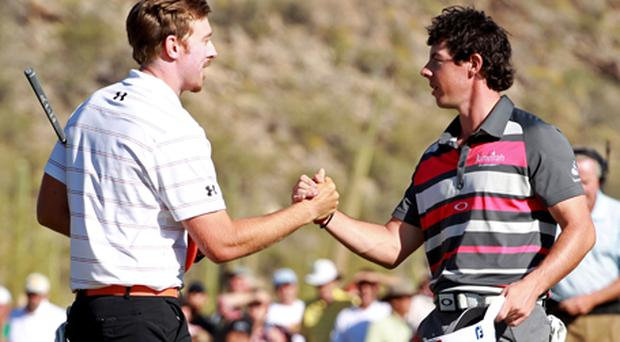 Hunter Mahan of the United States shakes hands with Rory McIlroy after his win. Photo: Getty Images