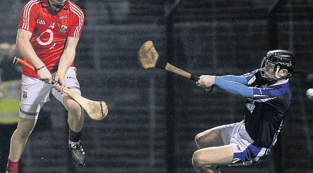 Cork's Paudie O'Sullivan shoots to score his side's first goal past Waterford goalkeeper Ian O'Regan at Pairc Ui Rinn on Saturday