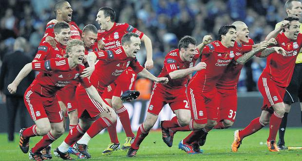 Liverpool players celebrate their victory