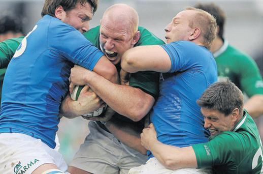 Paul O'Connell, supported by Ronan O'Gara (right), is tackled by Italy duo Antonio Pavanello