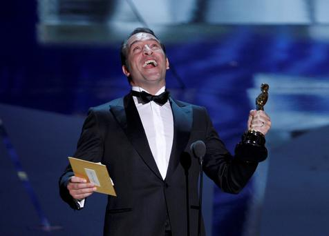 French actor Jean Dujardin accepts the Oscar for Best Actor for his role in the film