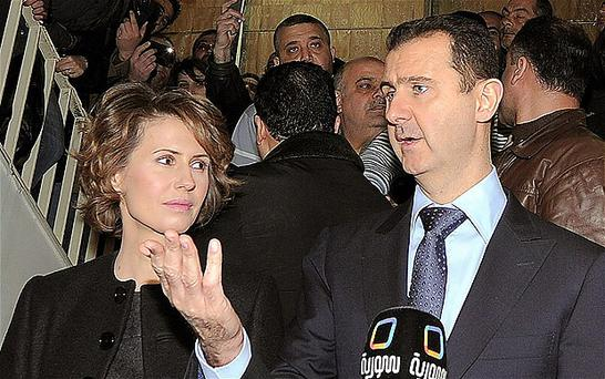 Syrian president Bashar Assad and his wife Asma talks to journalists yesterday
