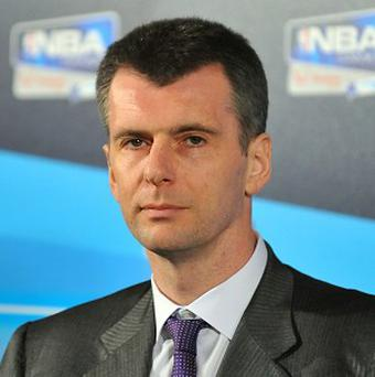 Mikhail Prokhorov, who owns a basketball team with rapper Jay Z, showcased his own rapping talents on a Russian TV show