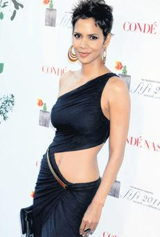 Halle Berry dares to bare and why not with that tummy.