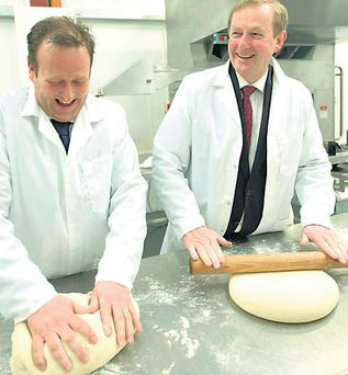 Enda Kenny, right, with baker Simon Stenson in Castlebar, Co Mayo, yesterday