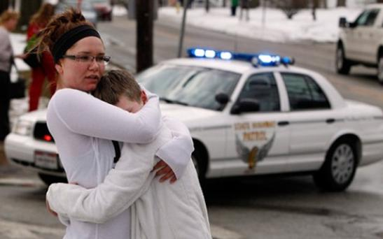 Daniel Kimball is consoled by his older sister Samantha after the Ohio school shooting