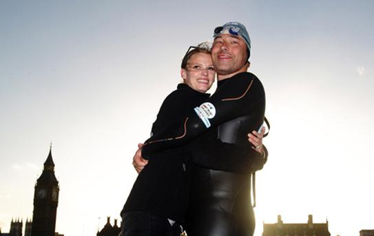 David Walliams and his wife Lara Stone who has put a halt to his plans to take on another challenge following his gruelling Thames swim. Photo: PA