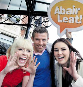 At the launch yesterday of Irish language social network Abair Leat, are comedian Des Bishop with TG4's Sile Ni Bhraonain, right, and Maire Treasa Ni Dhubhghaill. Photo: MARK STEDMAN