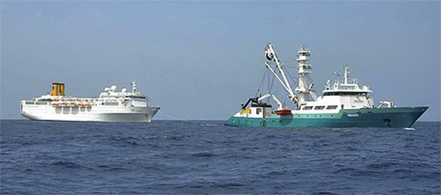 The Costa Allegra being towed by a French fishing vessel