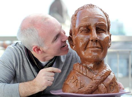 14/3/11***NO REPRO FEE***Cadbury Ray DArcy looks good enough to eat! Today FM DJ Ray DArcy met his chocolate double today with Cadbury Spots v Stripes Double Challenge winner Evelyn Mulcahy from Limerick. The chocolate bust is being auctioned in aid of the Crumlin Childrens Hospitals Easter party, to make a donation contact info@cmrf.org.The Cadbury Spots v Stripes Double Challenge asked members of the UK and Ireland to do something sporty whilst doing something else at the same time. A worthy winner, Evelyn Mulcahy from Limerick proved herself a true multi-tasker in her Work Time Play Time video.Evelyns prize included £5,000 and the unique opportunity to have a chocolate double of herself made by acclaimed chocolate artist Prudence Staite. This is only the second time that Cadbury has commissioned a chocolate bust, with a previous sculpture made of Elton John. Evelyn decided to have the chocolate double prize made of Ray DArcy and donate it to the Crumlin Childrens hospital in order to raise funds for the hospitals Easter party.Pic:Marc O'Sullivan