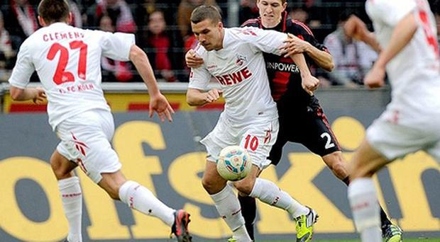 Transfer talk: Lukas Podolski (centre) could be available for £16m