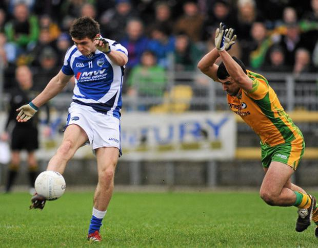 12 February 2012; Colm Begley, Laois, manages to score a point despite the efforts of Paddy McGrath, Donegal. Allianz Football League, Division 1, Round 2, Donegal v Laois, O'Donnell Park, Letterkenny, Co. Donegal. Picture credit: Oliver McVeigh / SPORTSFILE